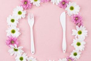 Many little cutlery flowers on pink