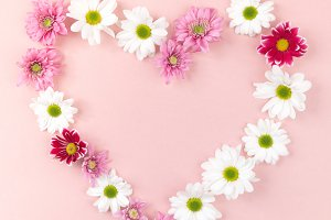 Heart shaped flowers on pink
