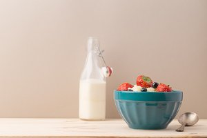 Bowl with yogurt and milk bottle
