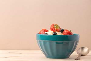 Bowl with fruits and yogurt