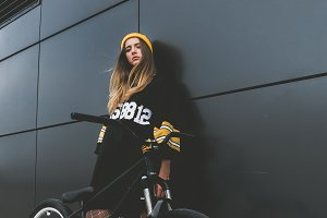 Girl posing with a street bicycle