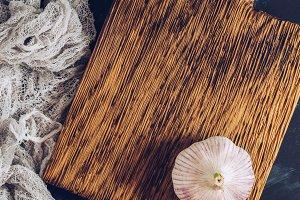 Garlic head on a small cutting board