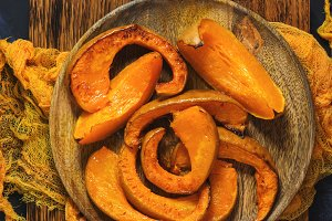 Pieces of baked pumpkin on a cutting