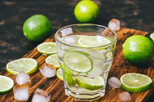Cold drink with lime and ice.