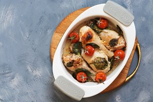 Baked chicken leg with tomatoes and