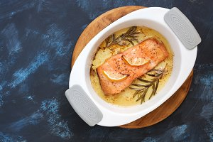 Baked salmon with rosemary in a cera