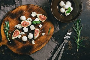 The appetizer with figs and cheese