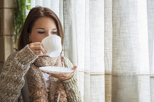 Woman drinking hot tea during winter