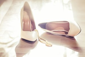 Wedding white shoes and pearls