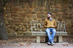 Man sitting outdoors in autumn.