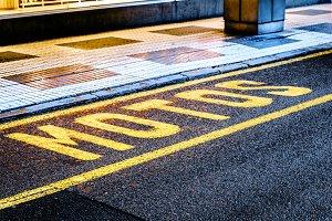 "Yellow ""motorcycle"" sign on asphalt"