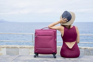 Woman with her travel suitcase.