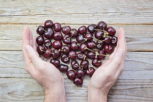 Heart of fresh and ripe cherries