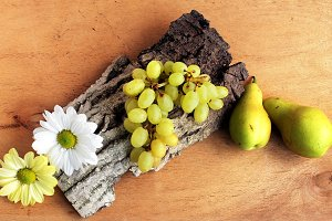 Food. Grapes, pears and flowers