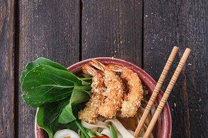 Bowl of delicious noodle soup with shrimps