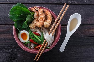 Bowl of delicious noodle soup with prawns