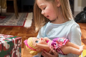 Young female caucasian girl opening presents