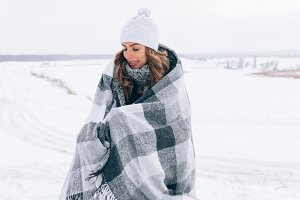 woman wear in gray blanket. winter