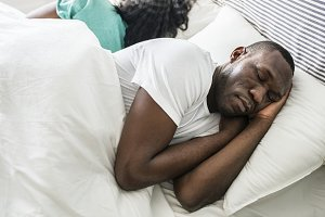 Black couple sleeping together