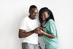 Black couple using a mobile phone