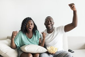 Black couple watching movie together