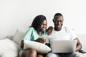 Black couple using digital devices