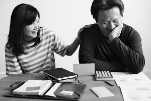Asian couple planning for financial
