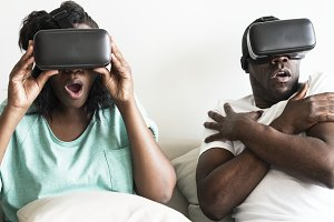 Couple is playing VR headset