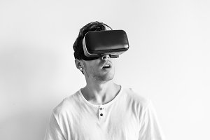 White man wearing VR headset
