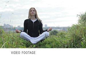 Yoga exercises outdoors. Meditating