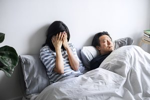 Asian woman in an unhappy marriage