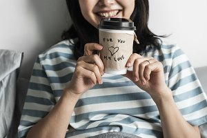 Asian woman with coffee cup