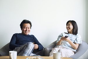 Asian couple watching movie