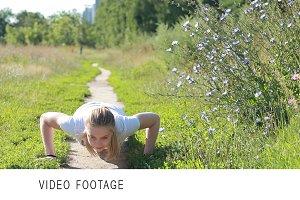 Young woman doing push ups