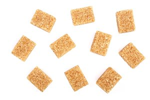 brown sugar cubes isolated on white background. Top view. Flat lay