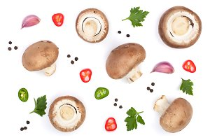 Fresh champignon mushrooms with parsley, peppercorns and red hot chili peppers isolated on white background. Top view