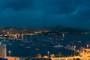 Mindelo in twilight. Port town with many boats in the bay on the Cape Verde in the northern part of the island Sao Vicente. Long exposure panoramic shot