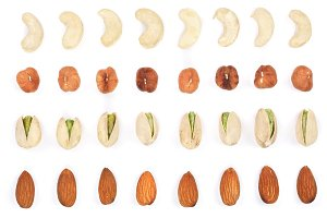 Mix nuts almonds, cashews hazelnuts pistachios isolated on white background. Top view. Flat lay