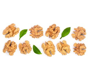 walnut kernels with leaves isolated on white background with copy space for your text. Top view. Flat lay