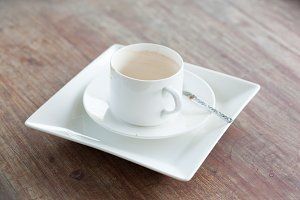 Coffee cup and white dish