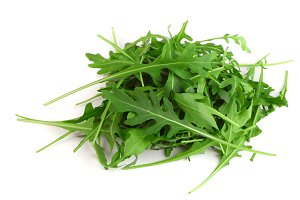 Heap of Green fresh rucola or arugula leaf isolated on white background