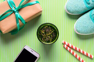Green smoothie, gift and smartphone