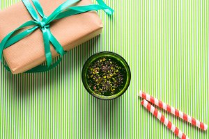 Green smoothie, gift box and straws