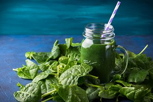 Green spinach spirulina smoothie in