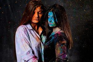 Powder shakes around two women