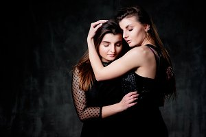 Tender hugs of two women posing