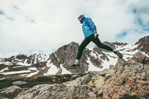 Active Man running in mountains