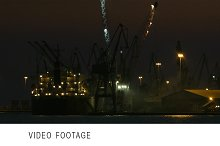 Unloading cargo ship at night 1
