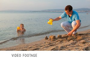 Father playing with his son at beach