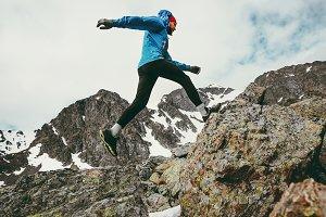 Travel Man running in mountains